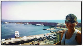 Lisa on Castel Nuovo balcony in Naples overlooking the harbor.