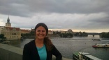 Standing on St Charles Bridge overlooking Vltava River