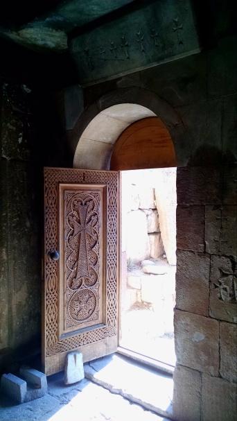 Monastery door with carved Khachkar