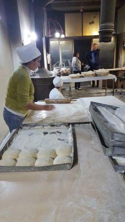 Woman #1 with dough piles