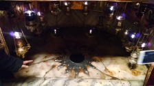 The supposed spot where Jesus was born. The star of Bethlehem (14 point star) marks the spot.