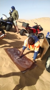 Waxing the wood for sandboarding