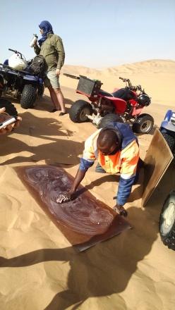 Waxing the wood for sandboarding