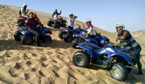 After sandboarding, ready to take off again. Photo credit: Quad biking guide